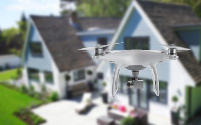 camera-drone-flying-house-stock